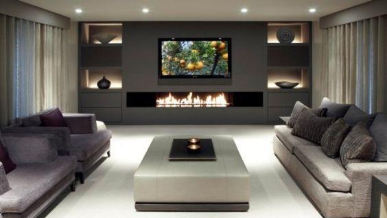 Электрокамин в интерьере гостиной с телевизором: встроенный электрокамин